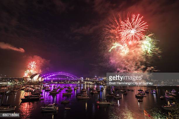 Fireworks explode over the Sydney Harbour Bridge and the Sydney Opera House during the 9pm show on New Year's Eve on Sydney Harbour on December 31...