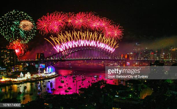 Fireworks explode over the Sydney Harbour Bridge during the midnight display on New Year's Eve on Sydney Harbour on January 1 2019 in Sydney Australia