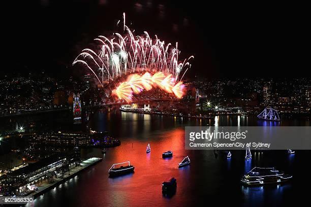 Fireworks explode over the Sydney Harbour Bridge on New Year's Eve on Sydney Harbour on January 1 2016 in Sydney Australia
