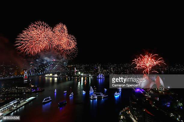 Fireworks explode over the Sydney Harbour Bridge on New Year's Eve on January 1 2016 in Sydney Australia