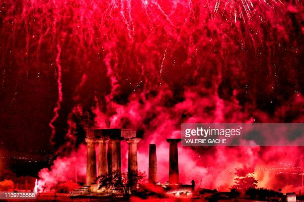 Fireworks explode over the Temple of Apollon in the village of Ancient Corinth during the traditional celebrations of the Orthodox Easter in Greece...