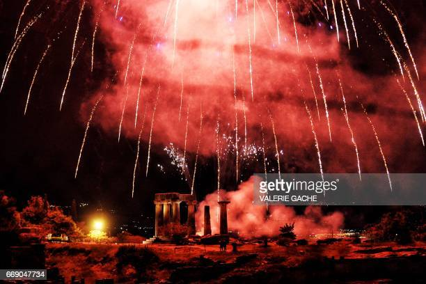 Fireworks explode over the Temple of Appolon in the villge of Ancient Corinth during the traditional celebrations of the Orthodox Easter early on...