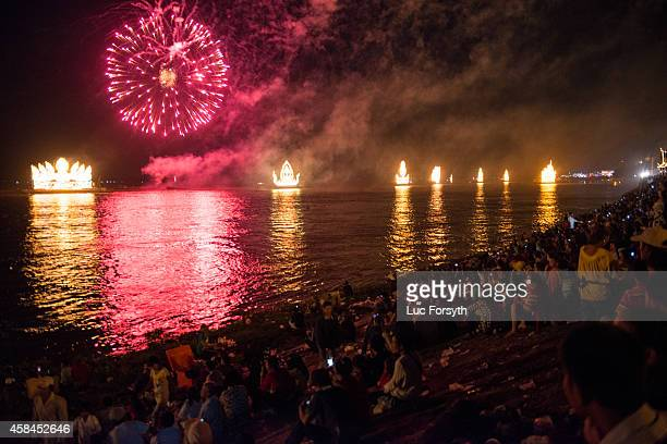 Fireworks explode over the Tonle Sap river during the Water Festival on November 5 2014 in Phnom Penh Cambodia Two million visitors were expected to...