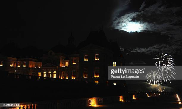 Fireworks explode over the Vaux le Vicomte castle illuminated by candles on August 21 2010 in Maincy outside Paris France At dusk the castle and...