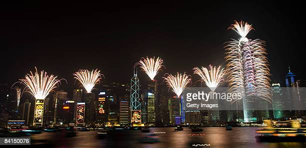 Fireworks explode over Victoria Harbour and the business district during a New Year's celebration January 1 2009 in Hong Kong China Cities around the...
