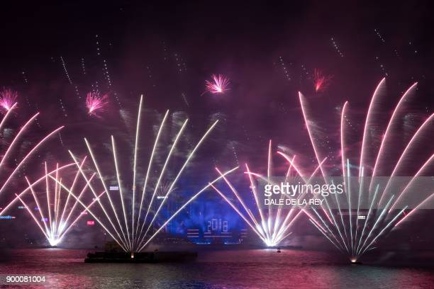 Fireworks explode over Victoria harbour during New Year celebrations in Hong Kong on January 1 2018 / AFP PHOTO / DALE DE LA REY