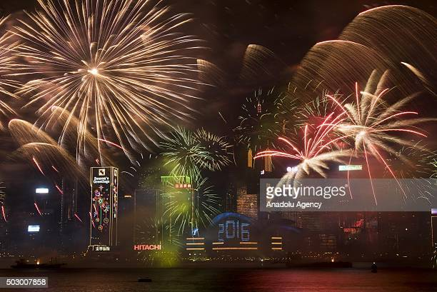 Fireworks explode over Victoria Harbour during the New Year's Eve celebrations on January 1 2016 in Hong Kong China