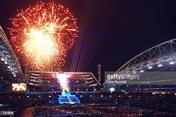 Fireworks explode September 15 2000 during the opening ceremony of the Sydney 2000 Olympic Games at the Olympic Stadium in Homebush Bay Sydney...