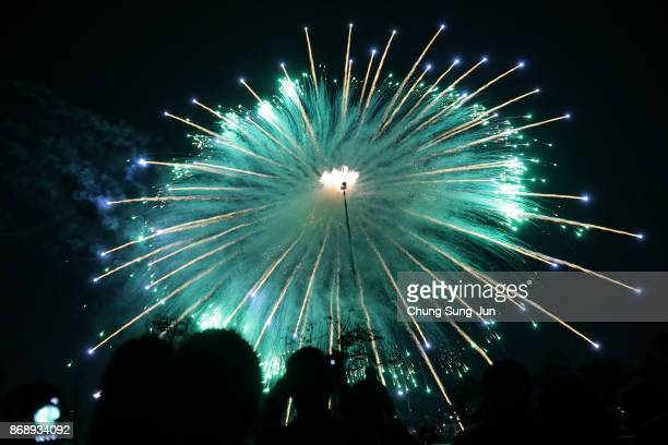 Fireworks explode to celebrate 100 days to go and the PyeongChang 2018 Winter Olympics torch during a torch relay on November 1 2017 in Incheon South...