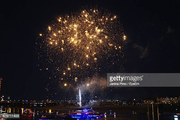 Fireworks Exploding Above Sea At Night