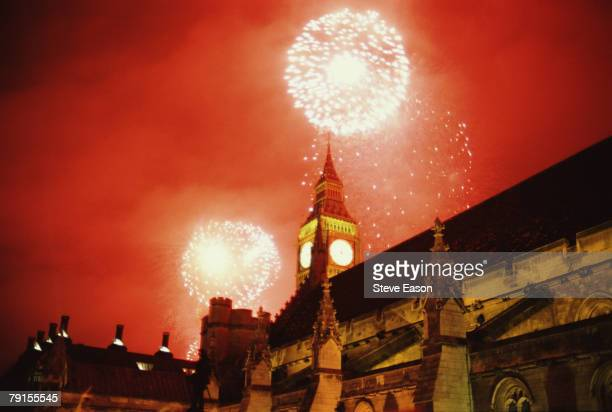 Fireworks exploding against a red sky over the Houses of Parliament and Big Ben as part of New Year's Eve celebrations to mark the new Millenium,...