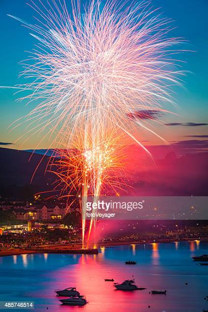 Fireworks exploding colourfully above seaside harbour resort Swanage Dorset