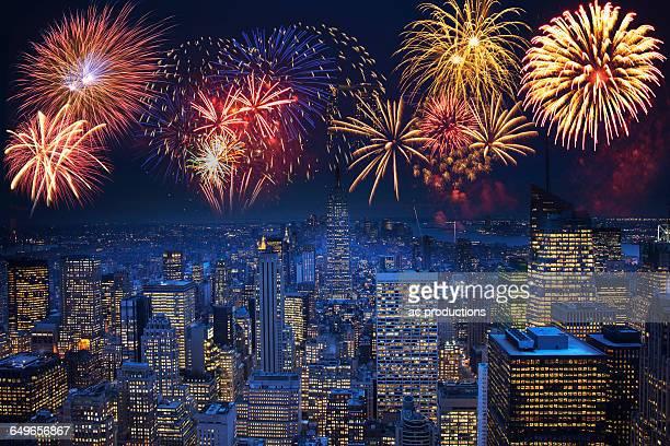 Fireworks exploding over illuminated cityscape, New York, New York, United States