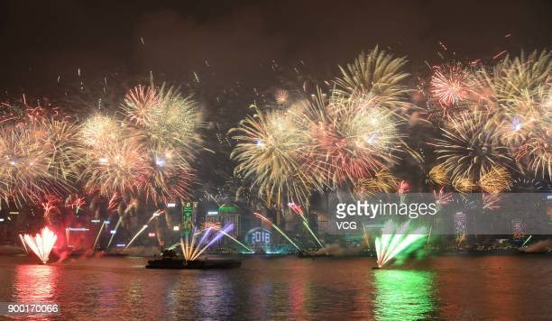 Fireworks explore over Victoria Harbour on New Year's Eve on January 1 2018 in Hong Kong China