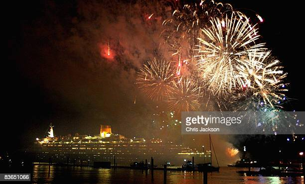 Fireworks expolode over the Queen Elizabeth II in Southampton as it leaves on its final voyage to Dubai on November 11 2008 in Southampton England...