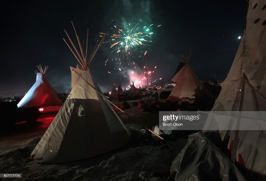 Fireworks fill the night sky above Oceti Sakowin Camp as activists celebrate after learning an easement had been denied for the Dakota Access Pipeline near the edge of the Standing Rock Sioux Reservation on December 4, 2016 outside Cannon Ball, North Dakota. The US Army Corps of Engineers announced today that it will not grant an easement to the Dakota Access Pipeline to cross under a lake on the Sioux Tribes Standing Rock reservation, ending a months-long standoff.