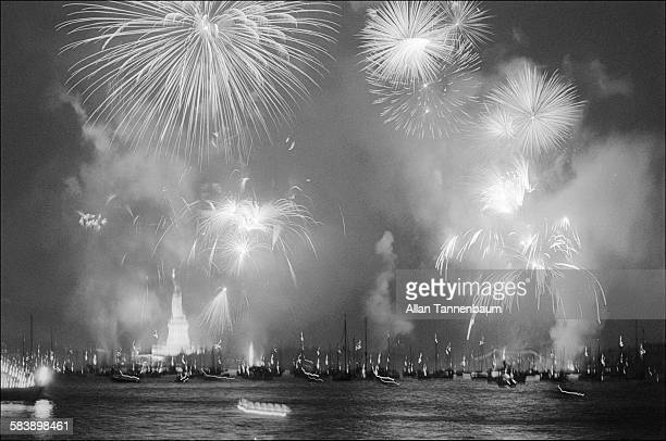 Fireworks fill the night sky over New York Harbor and the Statue of Liberty in celebration of America's Bicentennial New York New York July 4 1976