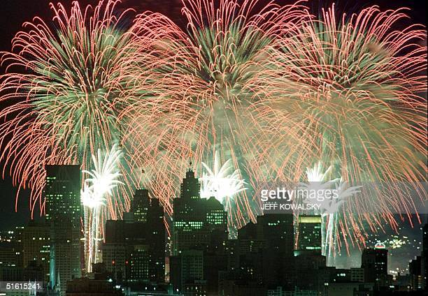 Fireworks fired from barges on the Detroit River as part of the International Freedom Festival light up the Detroit, Michigan skyline 30 June 1999....
