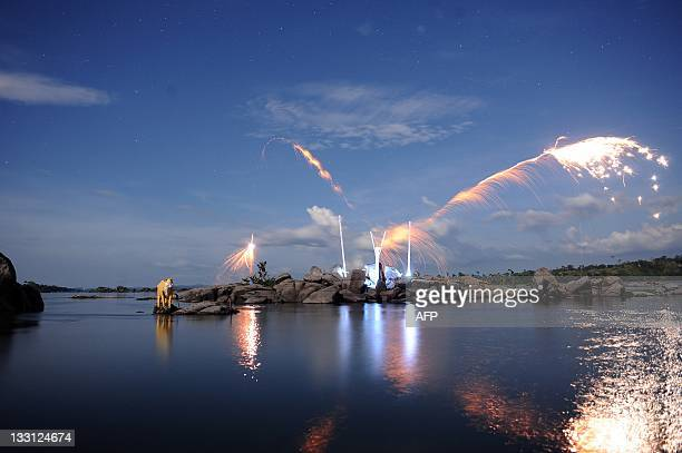 Fireworks fly into the night sky over sculptures and totem poles installed by British environmentalist David de Rothschild founder the community of...