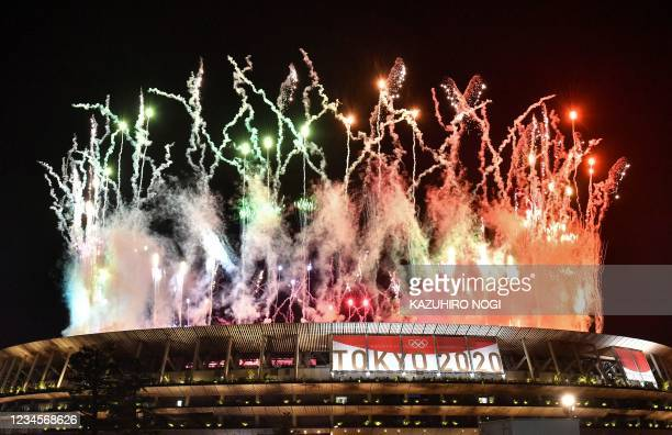 Fireworks go off around the Olympic Stadium during the closing ceremony of the Tokyo 2020 Olympic Games, as seen from outside the venue in Tokyo on...