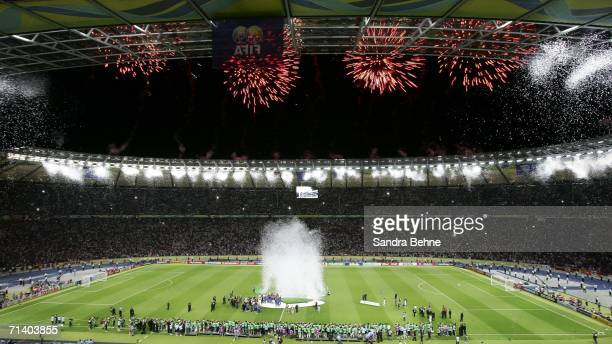 Fireworks go off around the stadium as Fabio Cannavaro the captain of Italy lifts the world cup trophy after his team's victory during the FIFA World...