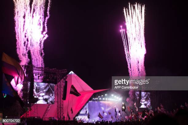 Fireworks go off as music fans watch the Foo Fighters perform on the Pyramid Stage at the Glastonbury Festival of Music and Performing Arts on Worthy...