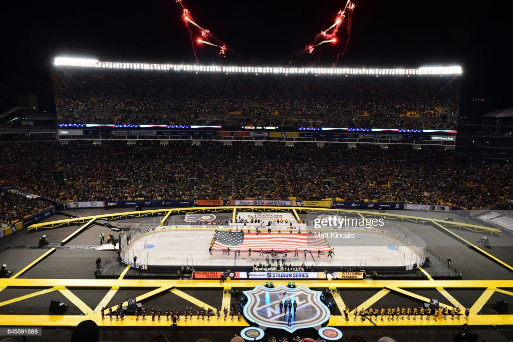 Fireworks go off as the National Anthem is sung before a game between the Pittsburgh Penguins and the Philadelphia Flyers at Heinz Field on February 25, 2017 in Pittsburgh, Pennsylvania.