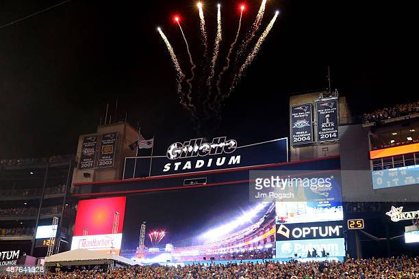 Fireworks go off as the New England Patriots reveal their Super Bowl XLIX championship banner before the game against the Pittsburgh Steelers at...