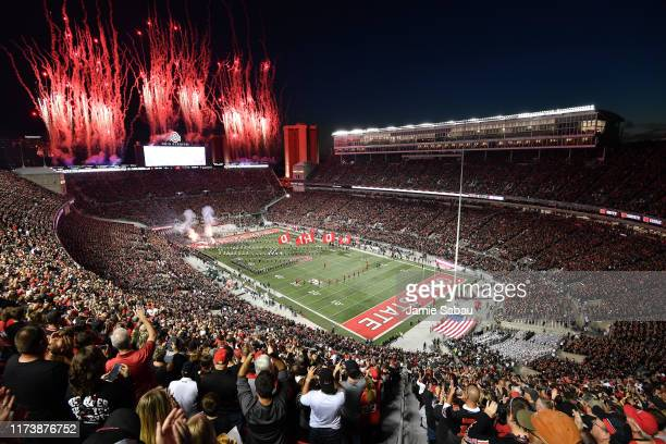 Fireworks go off as the Ohio State Buckeyes take the field for a game against the Michigan State Spartans at Ohio Stadium on October 5 2019 in...