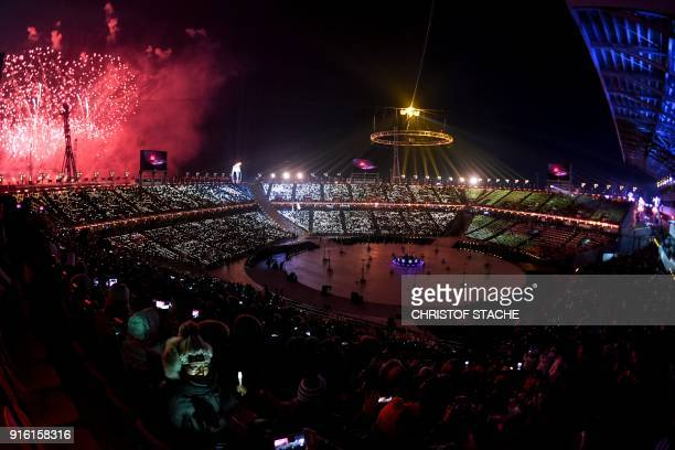 Fireworks go off as the Olympic Flame is lit during the opening ceremony of the Pyeongchang 2018 Winter Olympic Games at the Pyeongchang Stadium on...