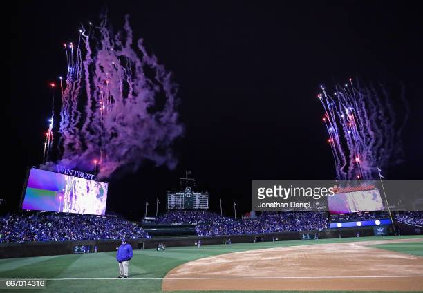 Fireworks go off as the World Series Championship banner is rasied before the home opening game between the Chicago Cubs and the Los Angeles Dodgers...