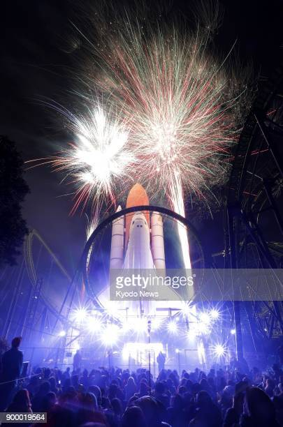 Fireworks go off at the Space World amusement park in Kitakyushu in southwestern Japan's Fukuoka Prefecture on Dec 31 2017 The event is the theme...