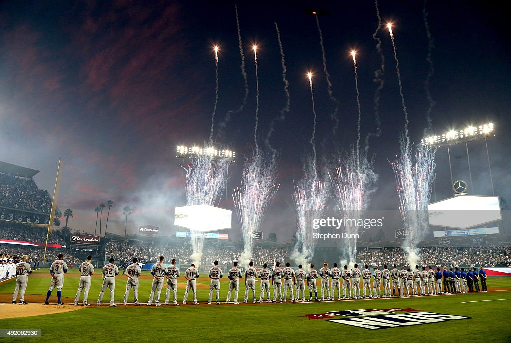 Fireworks go off during the national anthem before game one of the National League Division Series between the Los Angeles Dodgers and the New York Mets at Dodger Stadium on October 9, 2015 in Los Angeles, California.