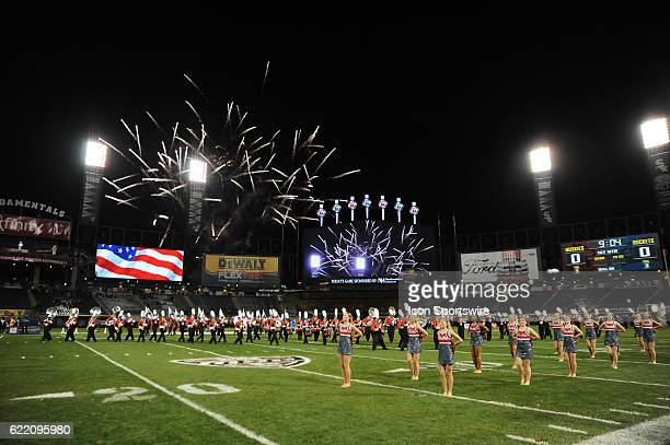 Fireworks go off during the national anthem prior to the first half during a MidAmerican Conference football game between the Toledo Rockets and...