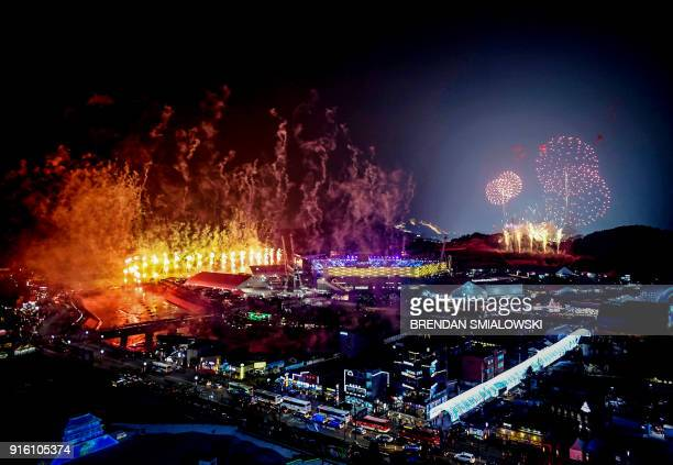 TOPSHOT Fireworks go off during the opening ceremony of the Pyeongchang 2018 Winter Olympic Games at the Pyeongchang Stadium on February 9 2018 / AFP...
