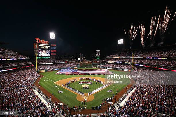 Fireworks go off during the singing of the National Anthem before the Philadelphia Phillies game against the Atlanta Braves on April 5 2009 at...