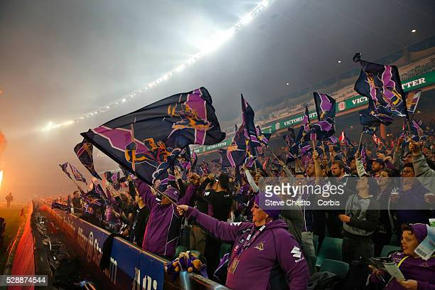 Fireworks go off in front of the Storm's fans during the Qualifying Final match between Sydney Roosters and Melbourne Storm at Allianz Stadium on...