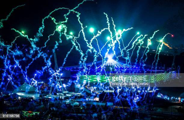 TOPSHOT Fireworks go off outside the stadium during the opening ceremony of the Pyeongchang 2018 Winter Olympic Games at the Pyeongchang Stadium on...
