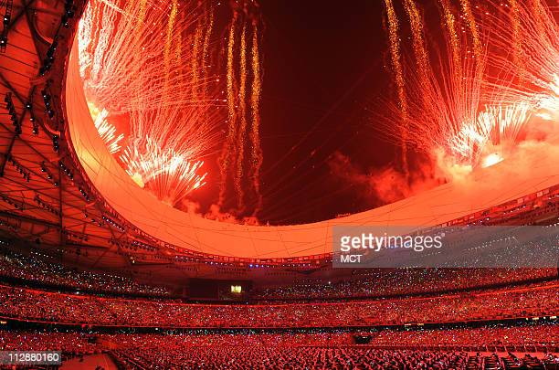 Fireworks go off over the National Stadium to the start of the opening ceremony on Friday August 8 to kick of the Games of the XXIX Olympiad in...