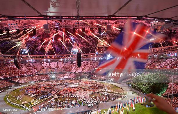 Fireworks go off over the Olympic stadium at the end of the opening ceremony of the London 2012 Olympic Games on July 28 2012 in London AFP PHOTO /...