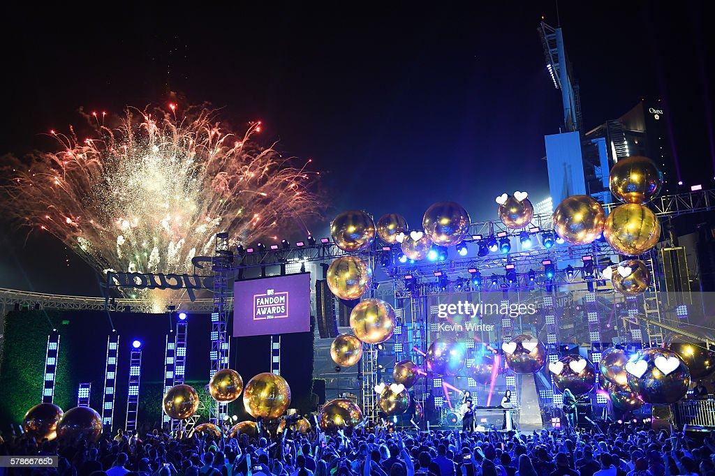 Fireworks go off while recording artists Jahan Yousaf and Yasmine Yousaf of musical group Krewella perform onstage at the MTV Fandom Awards San Diego at PETCO Park on July 21, 2016 in San Diego, California.