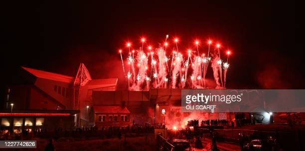 Fireworks illuminate Anfield stadium as the Liverpool football team are presented with the Premier League trophy inside Anfield in Liverpool, north...