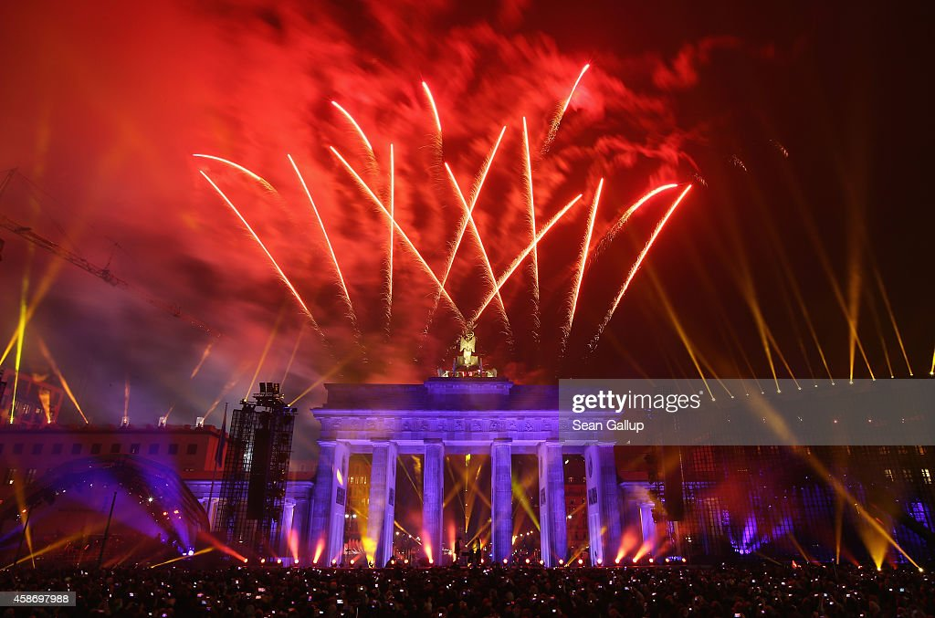 Fireworks illuminate the Brandenburg Gate during celebrations on the 25th anniversary of the fall of the Berlin Wall on November 9, 2014 in Berlin, Germany. The city of Berlin is commemorating the 25th anniversary of the fall of the Berlin Wall with an installation of 6,800 lamps coupled with illuminated balloons along a 15km route where the Wall once ran and divided the city into capitalist West and communist East. The fall of the Wall on November 9, 1989, was among the most powerful symbols of the revolutions that swept through the communist countries of Eastern Europe and heralded the end of the Cold War. Built by the communist authorities of East Germany in 1961, the Wall prevented East Germans from fleeing west and was equipped with guard towers and deadly traps.