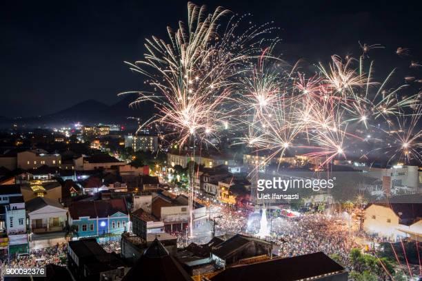 Fireworks illuminate the city's skyline during New Year's Eve celebrations of 2018 on on January 1 2018 in Yogyakarta Indonesia