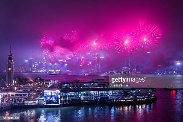 Fireworks illuminate the city's skyline on January 29 2017 in Hong Kong The Chinese Lunar New Year also known as the Spring Festival which is based...