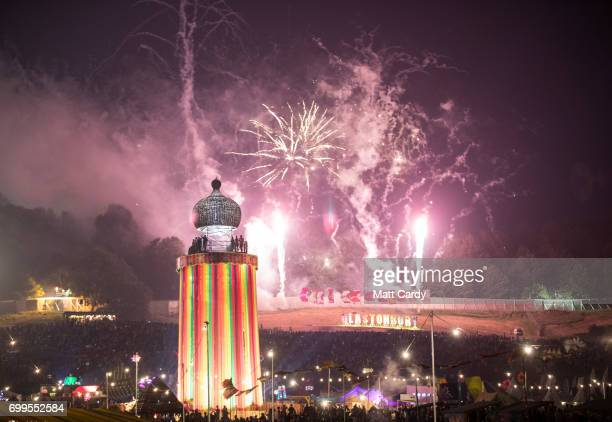 Fireworks illuminate the night sky at the end of the first day at the Glastonbury Festival at Worthy Farm in Pilton on June 21 2017 near Glastonbury...
