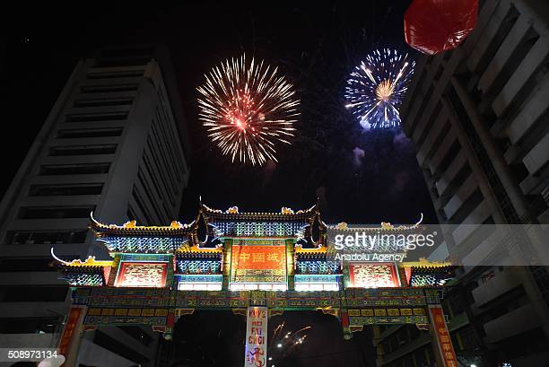 Fireworks illuminate the sky above the Chinatown friendship arch the largest in the world located in Binondo district Manilas Chinatown on Chinese...