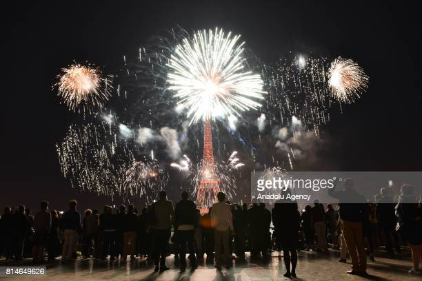Fireworks illuminate the sky around the Eiffel Tower as part of the Bastille Day celebrations in Paris France on July 14 2017