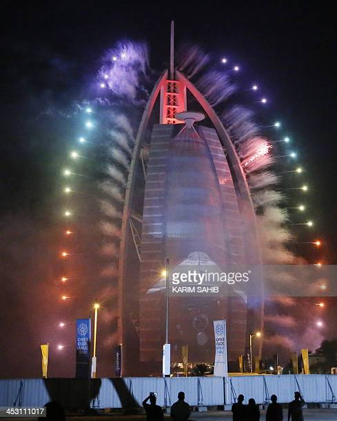 Fireworks illuminate the sky near Dubai's Burj Al Arab building during celebrations of the United Arab Emirates national day and the victory of Dubai...