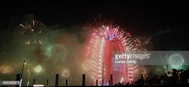 Fireworks illuminate the sky near Dubai's Burj AlArab during celebrations for the United Arab Emirates national day and Dubai's victory to host the...